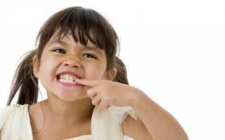 Почему ребенок скрипит зубами восне